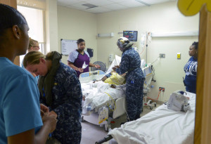 U.S. VIRGIN ISLANDS - SEPTEMBER 7: In this U.S. Navy handout, Hospital Corpsman 2nd Class Arinze Ugbah, assigned to Fleet Surgical team 2 (FST-2), provides aid to evacuees as part of first response efforts to the U.S. Virgin Islands in the wake of Hurricane Irma September 7, 2017. The Department of Defense is supporting Federal Emergency Management Agency (FEMA), the lead federal agency, in helping those affected by Hurricane Irma to minimize suffering and is one component of the overall whole-of-government response effort. (Photo by Levingston Lewis/U.S. Navy via Getty Images)